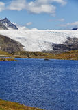 Lake and glacier tongue. Glacier tongue and lake at top of the mountain at jotunheimen national park in Norway stock images