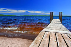 Lake Gogebic Landscape. Wooden dock and choppy waters of Lake Gogebic at Ontonagon County Park Michigan Stock Images