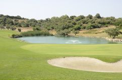 Lake in golf hole Royalty Free Stock Photo