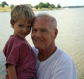 At the Lake with Grandpa. Young boy at Lake with his grandfather. Great for Father's Day. Part of Grandpa series stock photos