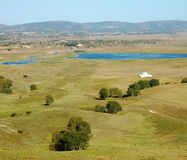 Lake in grassland Stock Images