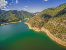 Lake and green forested hills. Lake and green forested hills on bright summer day Royalty Free Stock Images