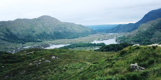 Lake and green hills. Kerry Mountains landscape. Lake and green hills. A scenic view of a Kerry Mountains and surrounding areas in County Kerry. Aged effect royalty free stock photo