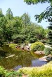 Lake in Green Japanese Garden Stock Images