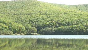 Lake in green mountains with clear clean water of Japan Sea. Transparent bottom. Calmness and silence. Rest and tourism in beautiful place. Unique landscape stock footage