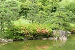 Lake, green plant, tree, flower in Japanese zen garden. Lake, green plant, tree and flower with reflection in Japanese zen garden Stock Image