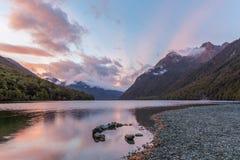Lake Gunn at sunrise with beautiful sun rays, Fiordland, New Zea Stock Photo