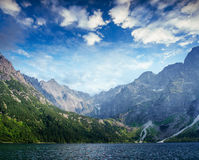 Lake Hallstatt under beautiful white clouds in blue sky. Royalty Free Stock Photo