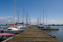 Lake and harbour. Boats at a harbour on a sunny day on a lake stock photography
