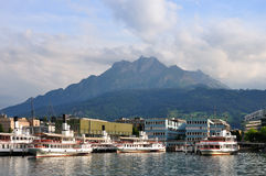 Lake harbour under Pilatus mountain, Switzerland Royalty Free Stock Photo