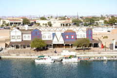 Lake Havasu City. United States - December 23, 2015: Colorful houses and boathouses on the waterfront of Lake Havasu with jetties on December 23, 2015 in Royalty Free Stock Photography