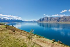 Lake Hawea, South Island, New Zeland. An outdoor adventurers' paradise. Lake Hawea is a favoured spot for wind surfing, paragliding and kite surfing Stock Photos