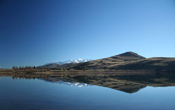 Lake Hayes, New Zealand. Lake Hayes, Queenstown, New Zealand, taken on a bright and clear winter day Stock Image