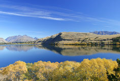 Lake Hayes, New Zealand. Lakes Hayes, New Zealand, with autumnal colours Stock Photo