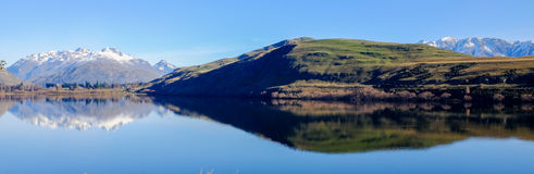 Lake Hayes, New Zealand. A panorama photo of Lake Hayes, New Zealand Royalty Free Stock Image