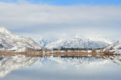 Lake Hayes with snow mountain reflections Royalty Free Stock Image