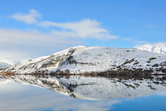Lake Hayes with snow mountain reflections Royalty Free Stock Images