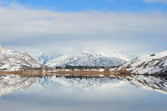 Lake Hayes with snow mountain reflections Stock Image
