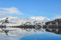 Lake Hayes with snow mountain reflections Stock Photos