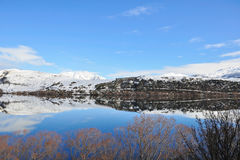 Lake Hayes with snow mountain reflections Stock Images