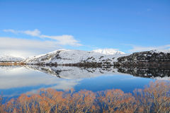 Lake Hayes with snow mountain reflections. Queenstown, New Zealand Stock Images