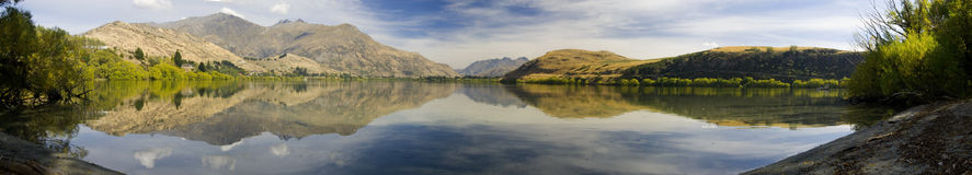 Lake Haze Panorama. A panorama of lake Lake Haze, NZ. Showing symmetrical reflection of surrounding hills Stock Photography