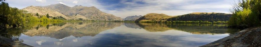 Lake Haze Panorama. A panorama of lake Lake Haze, NZ. Showing symmetrical reflection of surrounding hills stock photography