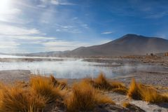 The lake is heated by a volcano at an altitude of five thousand meters above sea level in the Bolivian Alps Royalty Free Stock Image