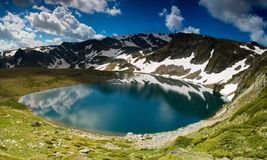 Lake in high mountain stock photography