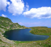 Lake high in the mountains. Beautiful blue lake high in the mountains in summer Stock Images