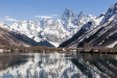 Lake and high mountains in clear weather, traveling and hiking. royalty free stock photos