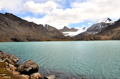 Lake high in the mountains of Kyrgyzstan. Alpine lake high in the mountains of Kyrgyzstan Stock Images