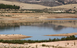 Lake and Hills in Southern Spain. A reflection of a lake and some hills in the dry mountainous Spanish countryside Royalty Free Stock Photography