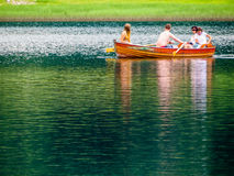 Friends on lake Royalty Free Stock Image