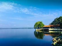 Lake house with blue sky. A house with a lake in sri lanka . there is a blue sky with some clouds Stock Photography