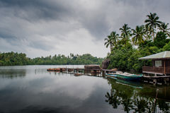 Lake with a house and boat in Sri Lanka royalty free stock image