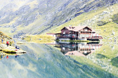 Lake house. Near mountain and reflections Royalty Free Stock Images