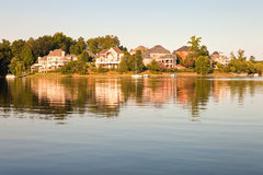 Lake and house on sunset Royalty Free Stock Image