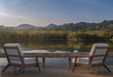 Lake house terrace and beautiful nature view 3d rendering image. A place surrounded by nature ,There are wood floor and furniture Stock Photo