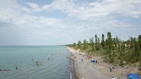 Lake Huron, beach and water. Aerial view. 4k. Lake Huron, Aerial view. Flying with drone above and along beach and lake stock footage