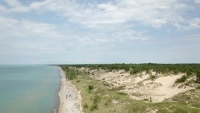Lake Huron, beach and water. Aerial view. 4k. Lake Huron, Aerial view. Flying with drone above and along beach and lake stock video