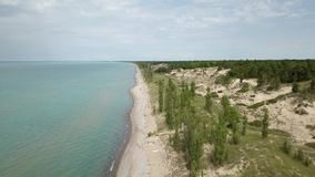 Lake Huron, beach and water. Aerial view. 4k. Lake Huron, Aerial view. Flying with drone above and along beach and lake stock video footage
