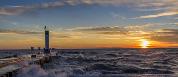 Lake Huron Lighthouse and Pier at Sunset Royalty Free Stock Photo