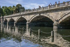The lake in the Hyde Park - the bridge and its reflection. Royalty Free Stock Photo