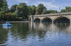 The lake in the Hyde Park - the bridge and some pedalo boats. Royalty Free Stock Photos