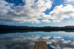Lake Ianthe with wooden jetty on calm sunny day Stock Photos