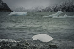 Lake of Ice. Ice Bergs float on an Alaskan lake during a spring storm Stock Photo