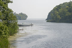 Lake inlet with boat Stock Photography