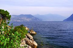 Lake Iseo, seen from its west bank. Lago d`Iseo or Sebino is the fourth largest lake in Lombardy, Italy, fed by the Oglio river. It is in the north of the royalty free stock images