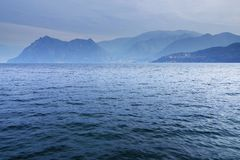Lake Iseo, seen from its west bank. Lago d`Iseo or Sebino is the fourth largest lake in Lombardy, Italy, fed by the Oglio river. It is in the north of the royalty free stock photo